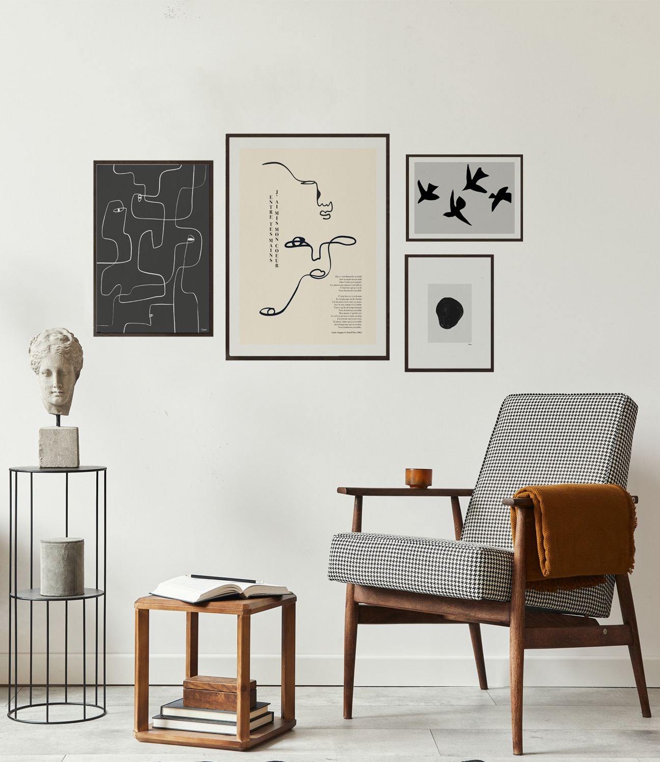 A Gallery Wall constructed with select statement pieces from our original in house collections, including poetry inspired line art and minimalism.